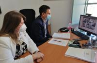 La concejala Julia Llopis y el gerente del patronato, en la reunión virtual